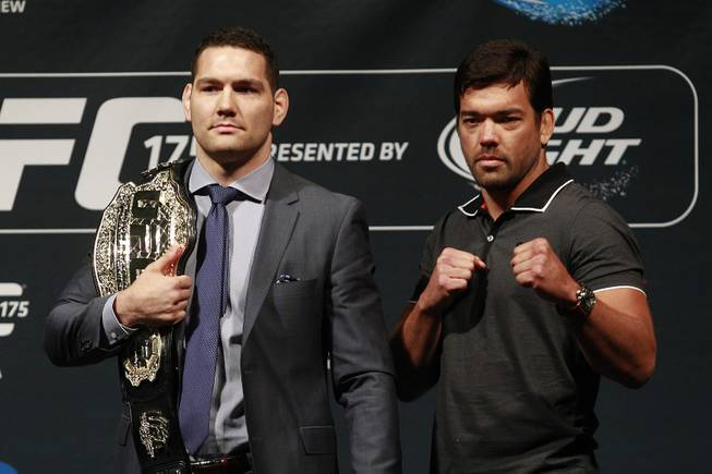 Chris Weidman and Lyoto Machida attend a news conference Friday, May 23, 2014, at MGM Grand Garden Arena to promote UFC 175. UFC 175 is July 5 at Mandalay Bay Events Center.
