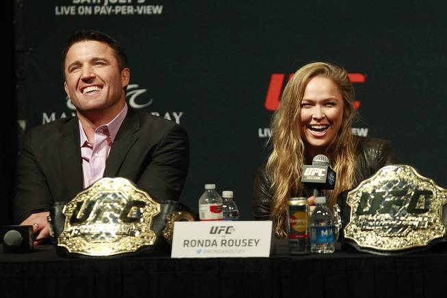 Champions Chael Sonnen and Ronda Rousey laugh during a news conference to promote UFC 175 Friday, May 23, 2014 at the MGM Grand Garden Arena. UFC 175 will be held July 5th, 2014 at the Mandalay Bay Events Center.