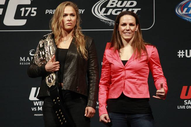 Ronda Rousey, left, and Alexis Davis pose during a news conference to promote UFC 175 Friday, May 23, 2014 at the MGM Grand Garden Arena. UFC 175 will be held July 5th, 2014 at the Mandalay Bay Events Center.