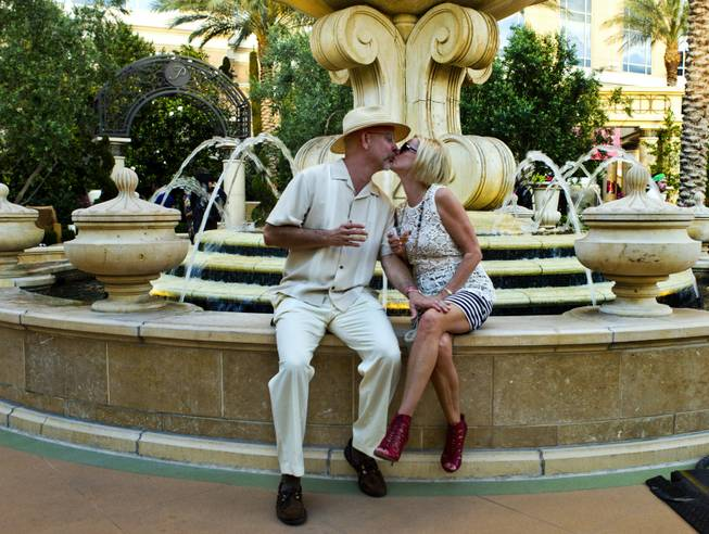 Dr. Ronald Reisch and wife Leslie share a kiss during the Epicurean Affair presented by the Nevada Restaurant Association at the Palazzo on Thursday, May 22, 2014.