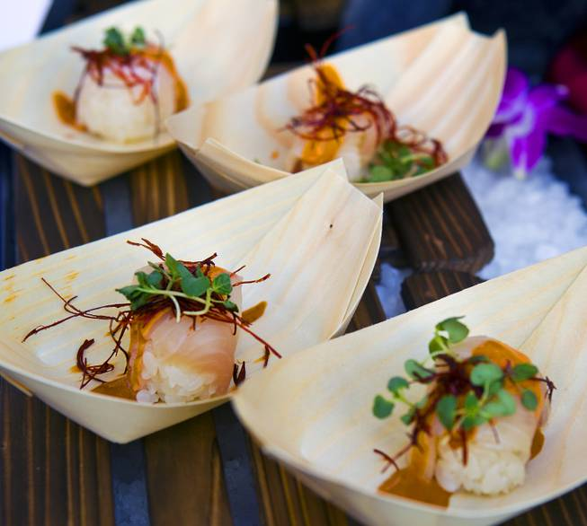Sushi samba serves a yellowtail sushi with lemongrass sauce during the annual showcase of nearly 75 of Las Vegas finest restaurants, nightclubs and beverage purveyors on Thursday, May 22, 2014.