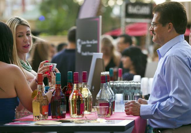 Attendees enjoy drinks from Southern Wine and Spirits of Nevada during the annual showcase of nearly 75 of Las Vegas finest restaurants, nightclubs and beverage purveyors on Thursday, May 22, 2014.