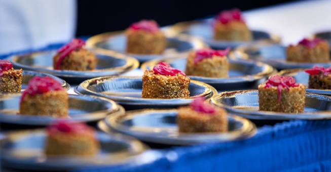 Canonita serves a quinoa fritter with goat cheese, pickled onion and rocoto sauce during the Epicurean Affair presented by the Nevada Restaurant Association at the Palazzo on Thursday, May 22, 2014.
