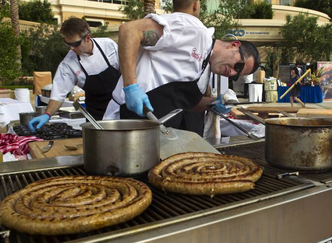 Christian Gonzalez with Buddy V's checks on the readiness of a homemade Italian sausage during the Epicurean Affair presented by the Nevada Restaurant Association at the Palazzo on Thursday, May 22, 2014.