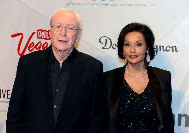 In this photo provided by the Las Vegas News Bureau, Sir Michael Caine  and wife Shakira arrive for the 17th annual Keep Memory Alive Power of Love Gala at MGM Grand Garden Arena in Las Vegas will raise funds for Cleveland Clinic Lou Ruvo Center for Brain Health and its fight against neurodegenerative brain diseases.