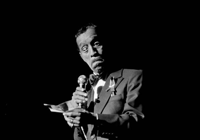 Sammy Davis Jr., reads a personal note to the audience at the opening of a benefit performance in Atlanta, March 10, 1981, to raise funds for the investigation into the deaths or disappearance of 21 Atlanta children.