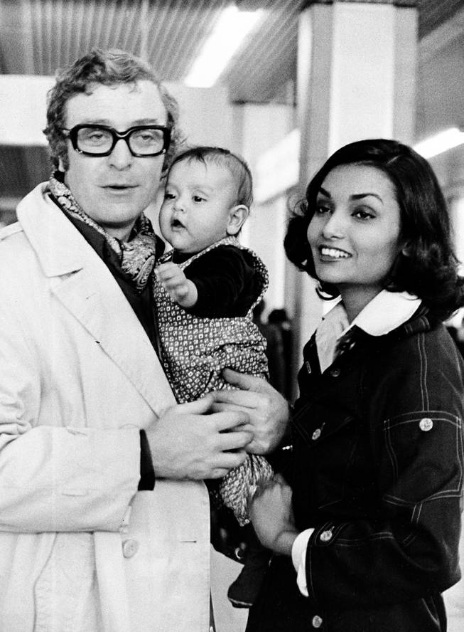 British actor Michael Caine is shown with his wife Shakira and their 5-month-old daughter Natasha at Nice Airport, France, Dec. 26, 1973.