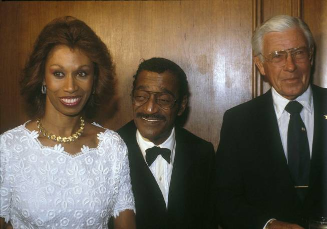 Sammy Davis Jr and his wife, Altovise Davis shown with Former U.S. Senator George Murphy at right, July 10, 1982 in Los Angeles.