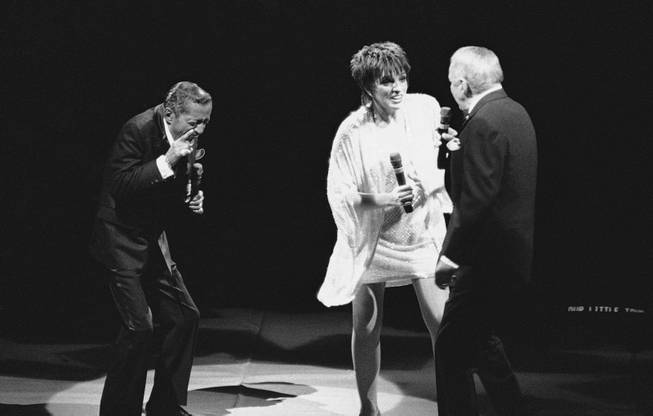 American entertainers Sammy Davis Jr., left, Liza Minnelli, middle, and Frank Sinatra, right, during their performance Saturday, April 9, 1989 at the Ahoy Hall in Rotterdam, Netherlands, this concert of the famous trio is part of their European tour.