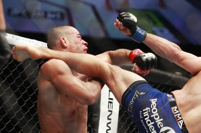 Blood flies off Renan Barao as he is hit with a leg from T.J. Dillashaw that nearly finishes him off in the fifth round during their title fight at UFC 173 on Saturday, May 24, 2014, at the MGM Grand Garden Arena. Dillashaw won shortly thereafter with a TKO.