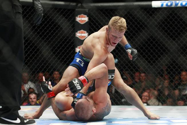 T.J. Dillashaw throws down punches on Renan Barao during their fight at UFC 173 Saturday, May 24, 2014 at the MGM Grand Garden Arena. Dillashaw scored an upset TKO in the fifth round.