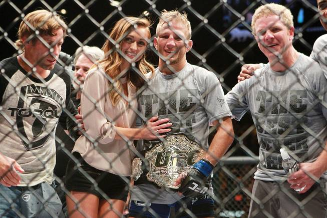 T.J. Dillashaw poses for photos after his upset TKO victory over Renan Barao in their bantamweight title fight at UFC 173 Saturday, May 24, 2014 at the MGM Grand Garden Arena.