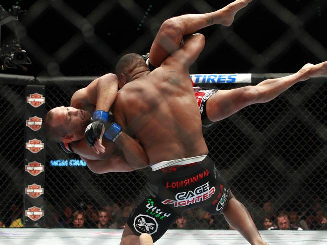 Daniel Cormier throws Dan Henderson during their fight at UFC 173 Saturday, May 24, 2014 at the MGM Grand Garden Arena. Cormier won by submission with a rear naked choke.