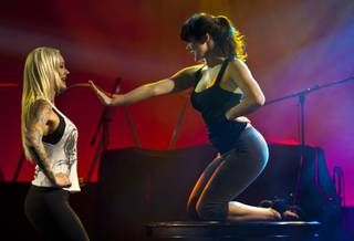 (From right) Claire Sinclair coaches Sabina Kelley as her understudy in a tabletop number for Pin Up at the Stratosphere Theater on Friday, May 23, 2014.