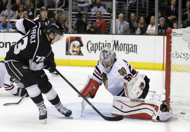 Los Angeles Kings center Tyler Toffoli scores past Chicago Blackhawks goalie Corey Crawford during the second period of Game 3 of the Western Conference finals of the NHL hockey Stanley Cup playoffs in Los Angeles, Saturday, May 24, 2014.