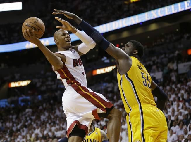 Miami Heat guard Ray Allen drives to the basket over Indiana Pacers center Roy Hibbert during the second half of Game 3 in the NBA basketball Eastern Conference finals playoff series Saturday, May 24, 2014, in Miami.