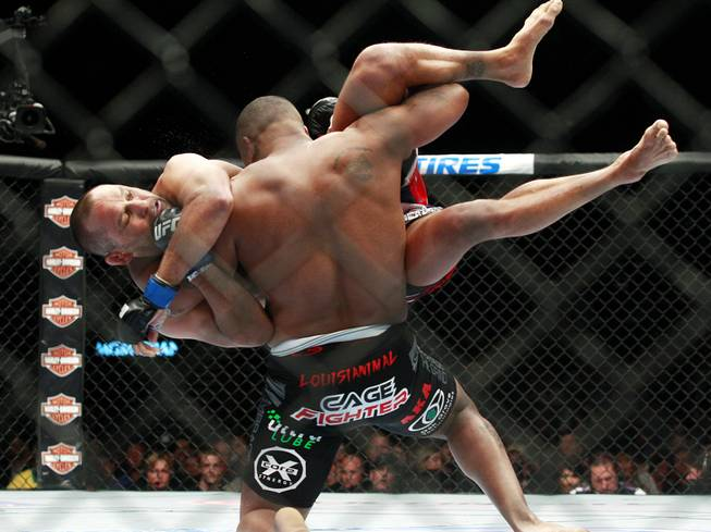 Daniel Cormier throws Dan Henderson during their fight at UFC 173 Saturday, May 24, 2014 at the MGM Grand Garden Arena. Cormier won with a rear naked choke in the third round.