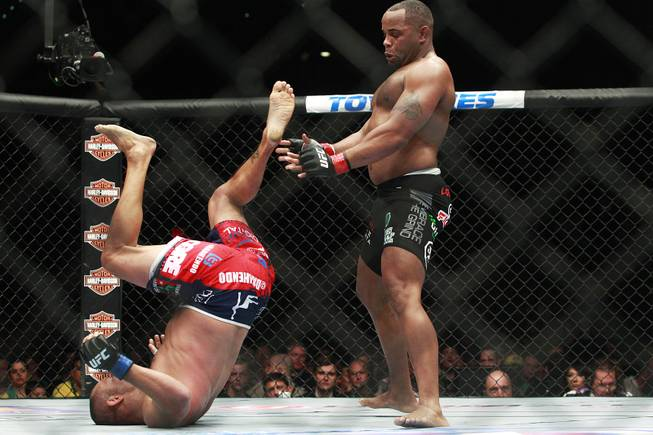 Daniel Cormier leaps back from Dan Henderson during their fight at UFC 173 Saturday, May 24, 2014 at the MGM Grand Garden Arena. Cormier won with a rear naked choke in the third round.