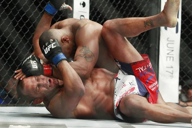 Daniel Cormier hits Dan Henderson with a left during their fight at UFC 173 Saturday, May 24, 2014 at the MGM Grand Garden Arena. Cormier won with a rear naked choke in the third round.