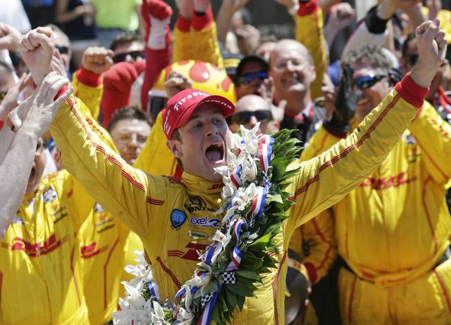 Ryan Hunter-Reay celebrates winning the 98th running of the Indianapolis 500 IndyCar auto race at the Indianapolis Motor Speedway in Indianapolis on Sunday, May 25, 2014.