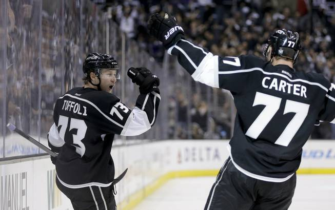 Los Angeles Kings center Tyler Toffoli, left, celebrates his goal with teammate Jeff Carter against the Chicago Blackhawks during the second period of Game 3 of the Western Conference finals of the NHL hockey Stanley Cup playoffs in Los Angeles on Saturday, May 24, 2014.