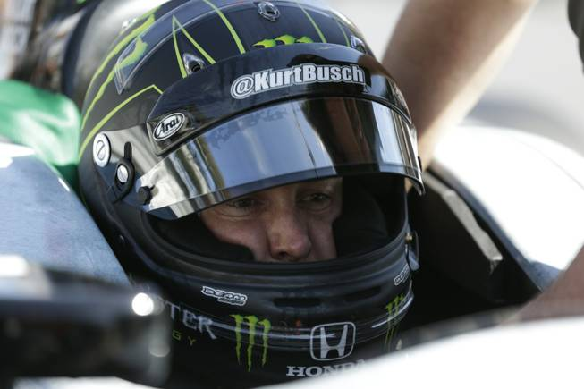 Race driver Kurt Busch practices at the Indianapolis Motor Speedway during the Rookie Orientation Program in Indianapolis, Tuesday, April 29, 2014. Busch will try to be the first driver in a decade to compete in IndyCar's Indianapolis 500 and Sprint Cup's Coca-Cola 600 on the same day.