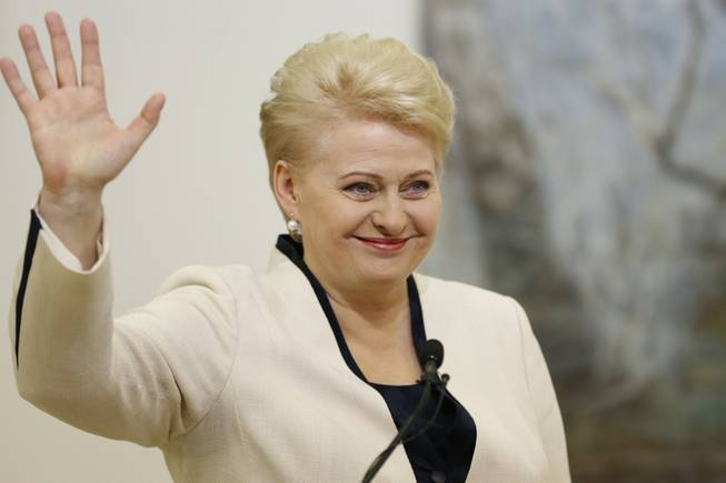 Lithuania's President Dalia Grybauskaite and presidential candidate celebrates winning a second term in office with his supporters in Vilnius, Lithuania on Sunday, May 26, 2014.