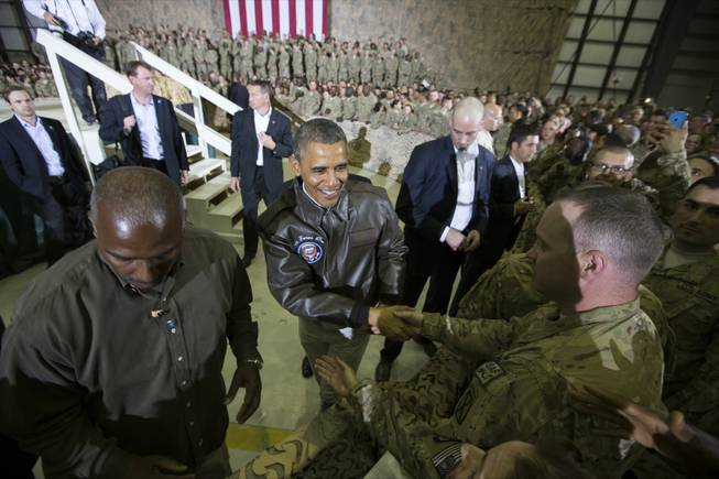 President Barack Obama shakes hands at a troop rally at Bagram Air Field, north of Kabul, Afghanistan, during an unannounced visit, on Sunday, May 25, 2014.