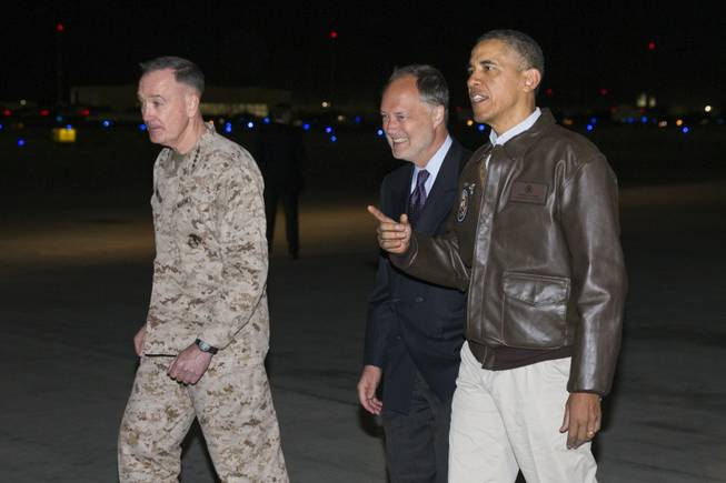 President Barack Obama, right, is greeted by U.S. Ambassador to Afghanistan James Cunningham, center, and Marine General Joseph Dunford, commander of the US-led International Security Assistance Force (ISAF), as he arrives at Bagram Air Field for an unannounced visit, on Sunday, May 25, 2014, north of Kabul, Afghanistan.