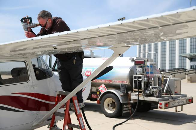 Mark Grisco fuels a small airplane at DuPage Airport in West Chicago, Ill., on May 9, 2014. Though not used in cars in the U.S., fuel containing lead is still used in some small, private aircraft.