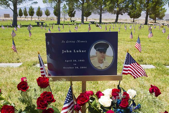 The grave site of Marine Pfc. John Lukac, a Durango High School graduate, is shown at the Southern Nevada Veterans Memorial Cemetery in Boulder City Monday, May 26, 2014. Lukac was killed while serving in Iraq during Operation Iraqi Freedom in October 2004.