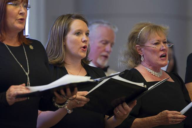 Members of the Nevada Opera Theater Chorus perform during a Memorial Day ceremony at the Southern Nevada Veterans Memorial Cemetery in Boulder City Monday, May 26, 2014.