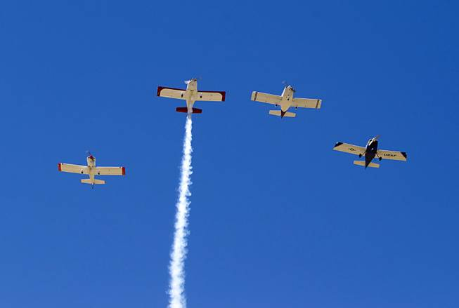 "The Boulder City Veterans Pilot Group flies in a ""Missing Man Formation"" during a Memorial Day ceremony at the Southern Nevada Veterans Memorial Cemetery in Boulder City Monday, May 26, 2014."