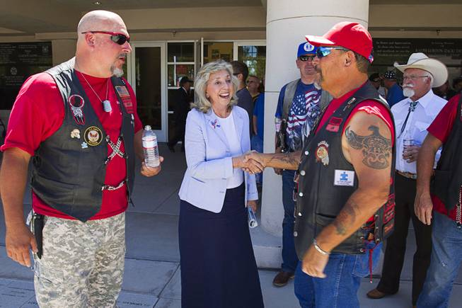 Congresswoman Dina Titus talks with members of Red Riderz, a local charity, during a Memorial Day ceremony at the Southern Nevada Veterans Memorial Cemetery in Boulder City Monday, May 26, 2014.