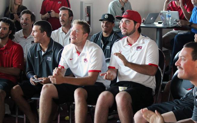 Members of UNLV's baseball team react to seeing their team make the NCAA Tournament field at a watch party at the Mendenhall Center on Monday, May 26, 2014. It's their first trip to a regional since 2005.