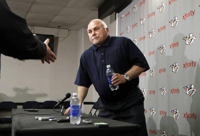 In this April 14, 2014, file photo, Nashville Predators coach Barry Trotz leaves a news conference in Nashville, Tenn. The Washington Capitals have promoted Brian MacLellan to general manager and hired former Predators coach Trotz. The team announced the moves Monday, May 26, 2014.