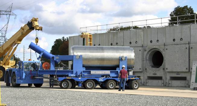 In this Oct. 14, 2010 photo released by Dominion Resources, a trailer holding a spent fuel storage container is maneuvered into position for offloading into a horizontal storage module at the Millstone Power Station in Waterford, Conn. With the collapse of a proposal for nuclear waste storage at Nevada's Yucca Mountain, Millstone and other plants across the country are building or expanding on-site storage for waste.