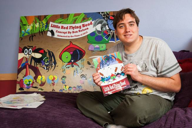 "Autistic author Ben Nelson, 20, is shown with his newly published book ""Little Red Flying Hood"" he wrote and graphically created with this fellow Foothill High School classmates in his home in Henderson May 23, 2014.  The paperback can be purchased online at Barnes & Noble."