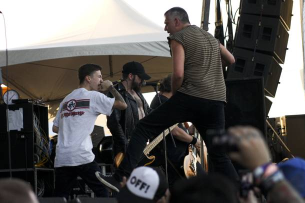 The Dwarves invite a fan to sing on stage during their set at the Punk Rock Bowling & Music Festival Sunday, May 25, 2014.