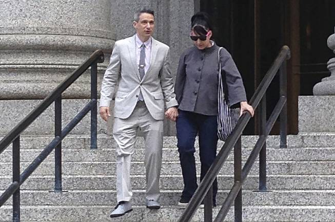 "The Beastie Boys rapper Adam ""Ad-Rock"" Horovitz leaves federal court in Manhattan on Tuesday, May 27, 2014, in New York with his wife Kathleen Hanna after testifying at a copyright trial stemming from a lawsuit his musical group brought against a beverage maker over the use of five of their songs in a video."