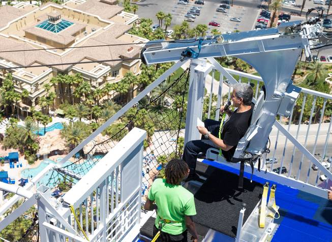 Bruce Buffer (strapped in seat) kicked off the opening of Rio's VooDoo Zip Line Sunday, May 25, 2014.  Courtesy of Rio Photo credit to Erik Kabik.