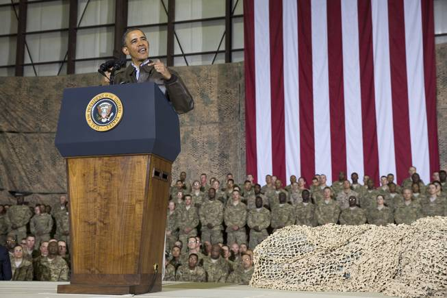 This May 25, 2014, file photo shows President Barack Obama speaking during a troop rally after arriving at Bagram Air Field for an unannounced visit, north of Kabul, Afghanistan. Senior U.S. administration officials say  Obama will seek to keep 9,800 U.S. troops in Afghanistan after the war formally ends later this year. Nearly all of those forces are to be out by the end of 2016, as Obama finishes his second term.