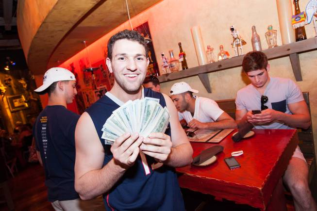 On Saturday, May 24, 2014, graduates of the University of Connecticut stopped by Hard Rock Hotel Las Vegas to pick up their winnings: a total of $60,000. Harrison Fuchs at Pink Taco inside the Hard Rock displays his $5,000 winnings.