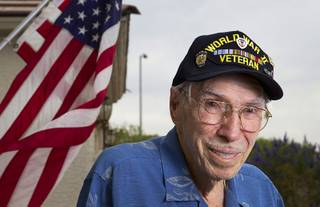 World War II veteran Davis B. Leonard poses at his home in Henderson Wednesday, May 28, 2014. Leonard and Gaetano