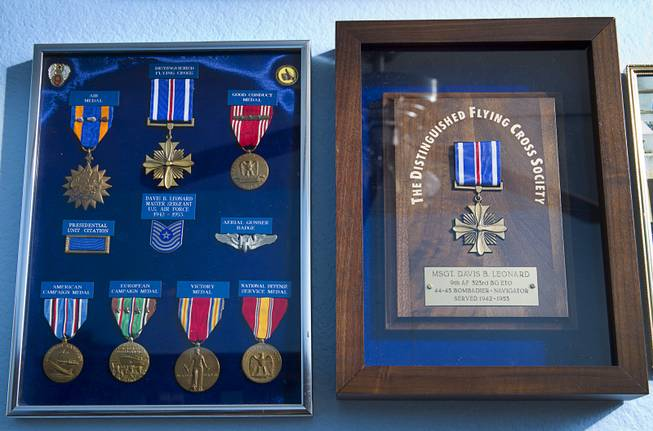 "Medals, including the Distinguished Flying Cross, right, are displayed in the home of World War II veteran Davis B. Leonard in Henderson Wednesday, May 28, 2014. Leonard and Gaetano ""Guy"" Benza, another local World War II veteran, will receive the French Legion d'Honneur award on Friday. The award is the highest honor France bestows on its citizens and foreign nationals."