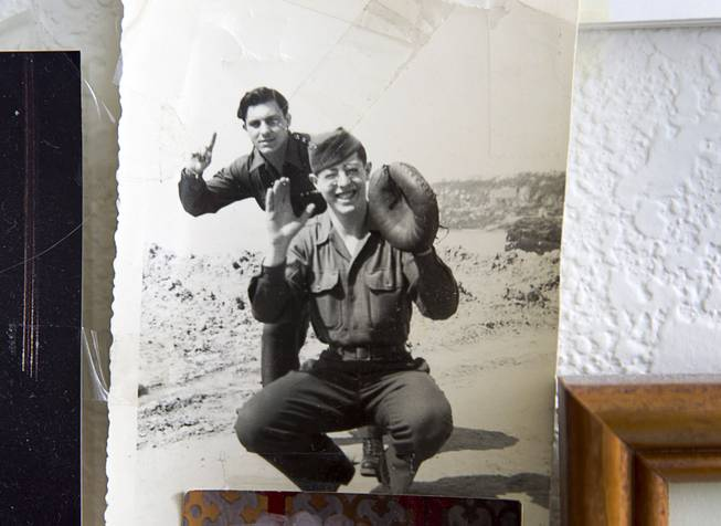 "A 1944 photo of World War II veteran Gaetano ""Guy"" Benza, left, and friend Bernie Donitz, is displayed in Benza's home in North Las Vegas Wednesday, May 28, 2014. Benza and Davis Leonard, another local World War II veteran, will receive the French Legion d'Honneur award on Friday. The award is the highest honor France bestows on its citizens and foreign nationals. A"