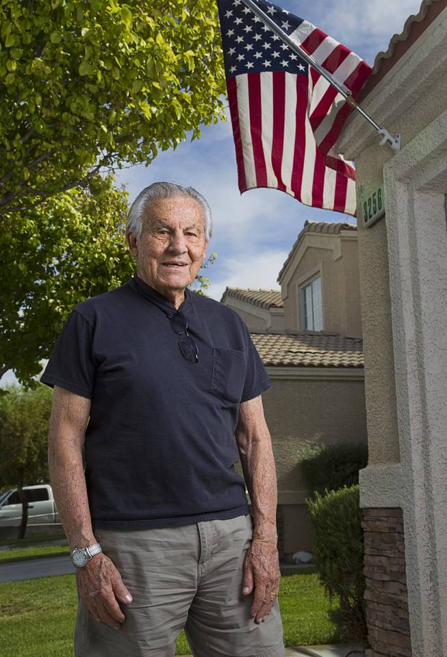 "World War II veteran Gaetano ""Guy"" Benza poses outside his home in North Las Vegas Wednesday, May 28, 2014. Benza and Davis Leonard, another local World War II veteran, will receive the French Legion d'Honneur award on Friday. The award is the highest honor France bestows on its citizens and foreign nationals."