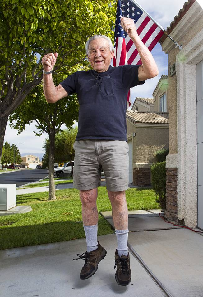 "World War II veteran Gaetano ""Guy"" Benza jumps as he shows off his physical fitness outside his home in North Las Vegas Wednesday, May 28, 2014. Benza and Davis Leonard, another local World War II veteran, will receive the French Legion d'Honneur award on Friday. The award is the highest honor France bestows on its citizens and foreign nationals."