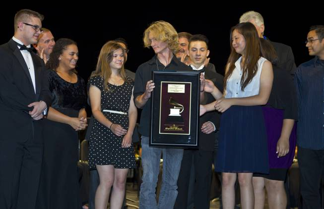 Las Vegas Academy of the Arts students hold their GRAMMY Signature Schools Gold Award during the presentation for achieving GRAMMY Signature Schools Gold status on Wednesday, May 28, 2014.