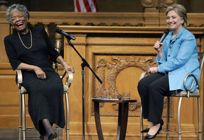 In this April 18, 2008 file photo, then U.S. Sen. Hillary Rodham Clinton, D-N.Y., right, speaks as poet Maya Angelou reacts during a campaign stop at Wake Forest University in Winston-Salem, N.C.
